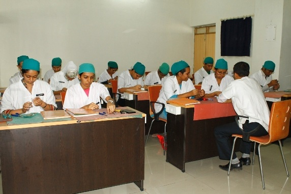 Faculty conducting clinical demonstration for undergraduate students